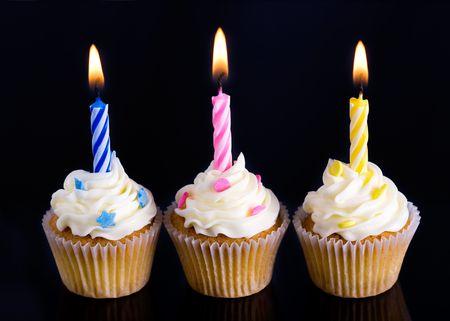 trio: Trio of birthday cupcakes against black