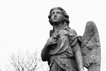 Statue adorning a grave looks heavenward