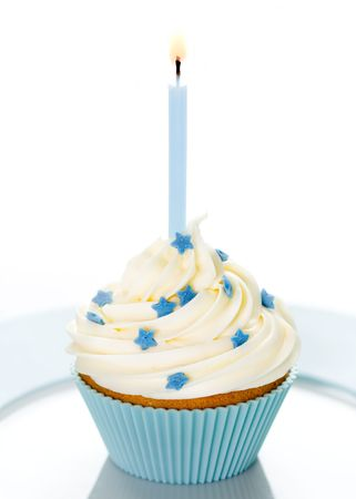 birthday candle: Blue birthday cupcake on a white plate Stock Photo