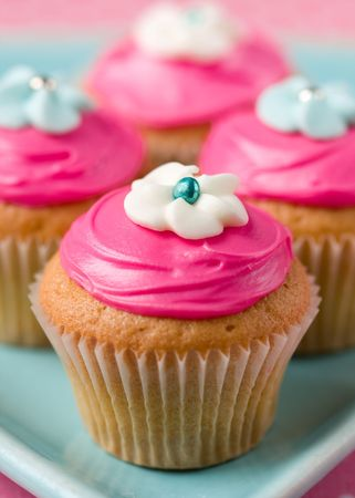 butter icing: Pink cupcakes  Stock Photo