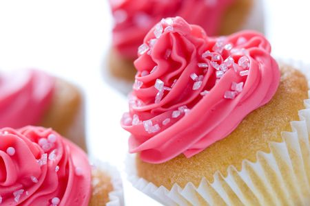 frosting: Closeup of pink cupcakes