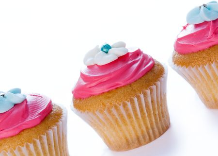 slanted: Three cupcakes in a row Stock Photo