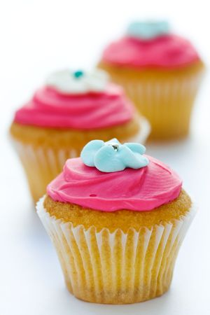 trio: Trio of pink cupcakes against white