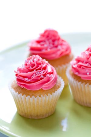 fairy cakes: Cupcakes decorated with pink sugar sprinkles