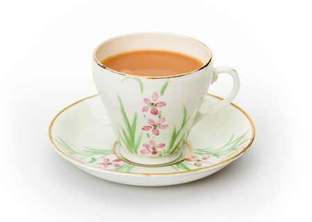 English tea served in a hand painted cup and saucer  photo