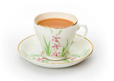 Ingl�s t� servido en una taza pintada a mano y platillo