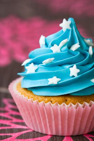 Blue and pink cupcake decorated with white sugar stars