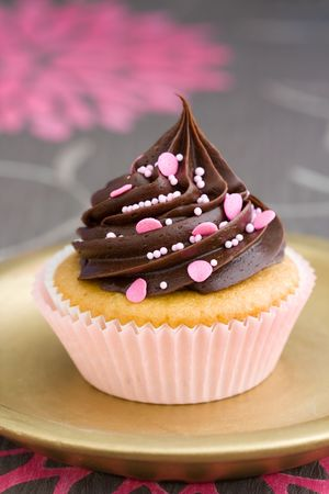 Pink chocolate cupcake served on a gold plate Stock Photo - 4894683