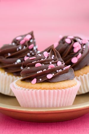 trio: Trio of pink chocolate cupcakes on a plate Stock Photo