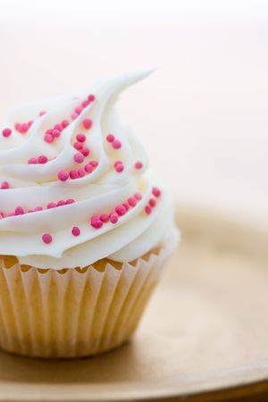 hundreds and thousands: Cupcake decorated with pink sugar sprinkles Stock Photo
