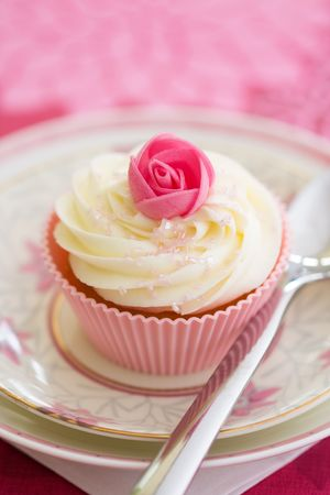 Pink rosebud cupcake Stock Photo - 5243486