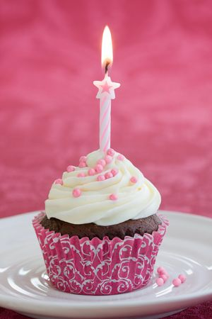cake with icing: Birthday cupcake Stock Photo