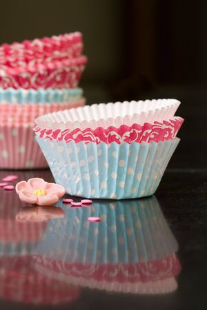 Colorful paper cupcake cases on a kitchen worktop photo