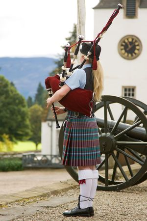 scotland: Bagpipe player in front of Blair Castle, Perthshire, Scotland