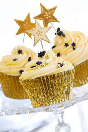 cake pick: Golden cupcakes Stock Photo