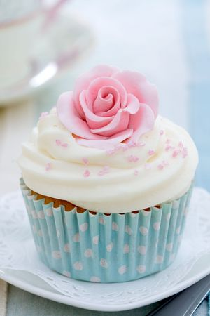 afternoon fancy cake: Cupcake decorated with a pink sugar rose Stock Photo