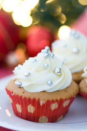 Cupcakes against a background of de-focused Christmas lights photo