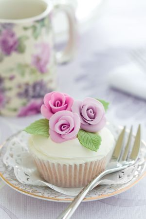 afternoon fancy cake: Purple rose cupcake Stock Photo