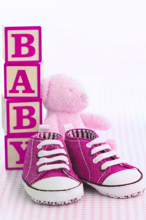 Pink baby shoes photo