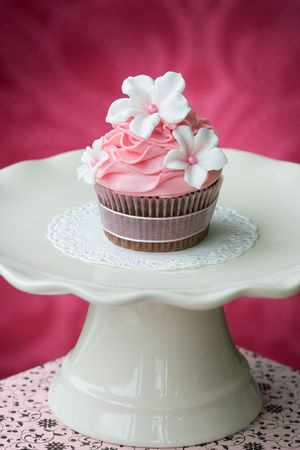 gum paste: Pink cupcake on a cream colored cakestand