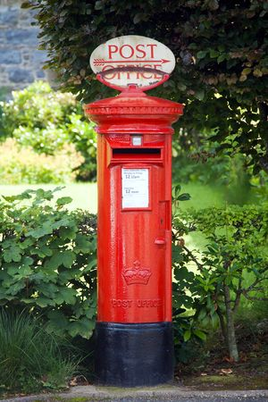 english countryside: Traditional British postbox