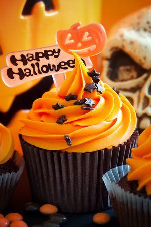 baked treat: Happy Halloween cupcakes Stock Photo