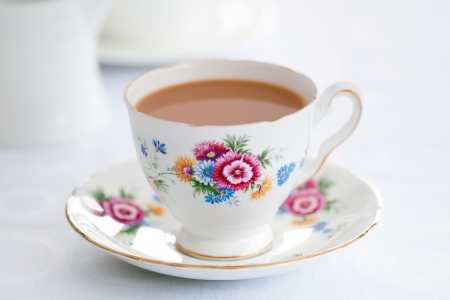 english culture: Tea served in a vintage teacup