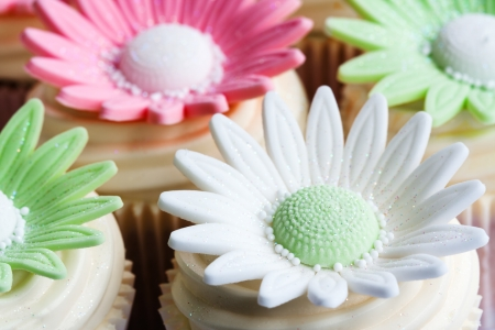 Cupcakes decorated with sugar flowers photo
