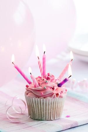 lit candle: Birthday cupcake Stock Photo