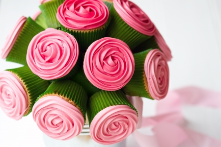 cupcake: Bouquet of rose cupcakes tied with a ribbon