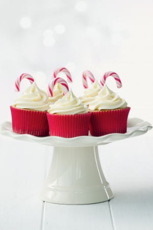 dessert stand: Festive cupcakes decorated with candy canes Stock Photo