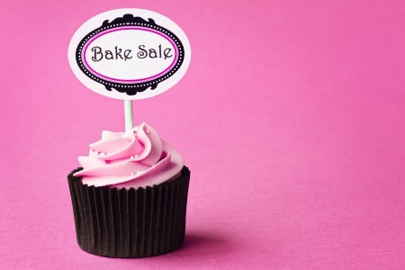 bake sale sign: Cupcake for a bake sale Stock Photo