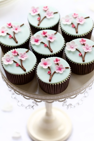 fairy cakes: Cherry blossom cupcakes Stock Photo