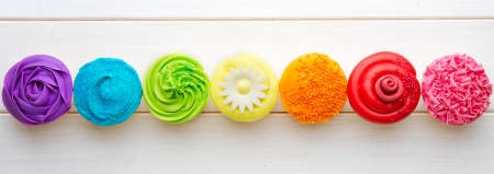 overhead view: Row of colorful cupcakes