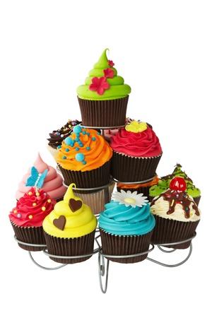 Kleurrijke cupcakes op een cakestand