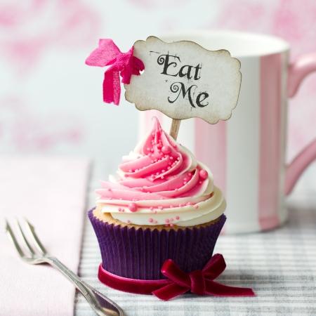 「Eat Me」を選ぶとカップケーキ 写真素材