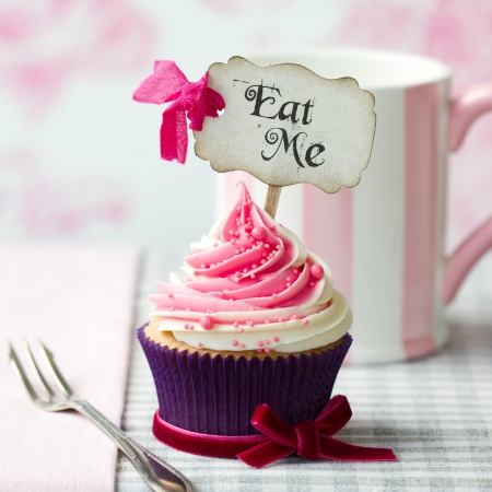 Cupcake with 'Eat Me' pick photo