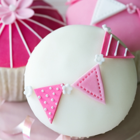 Cupcakes decorated with fondant bunting Stock Photo - 24928825