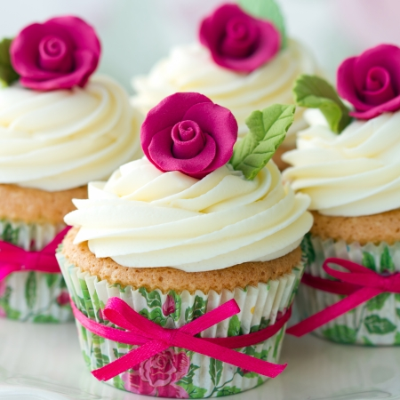gumpaste: Cupcakes decorated with pink sugar roses Stock Photo