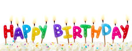 白に対して隔離される誕生日の蝋燭 写真素材