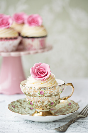 Afternoon tea with rose cupcakes  photo