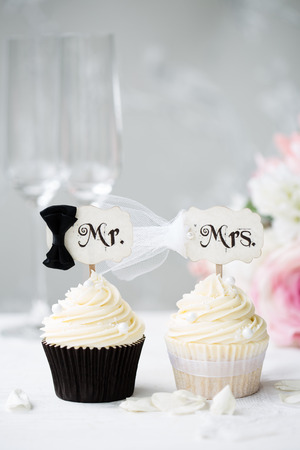 cake pick: Bride and groom cupcakes  Stock Photo