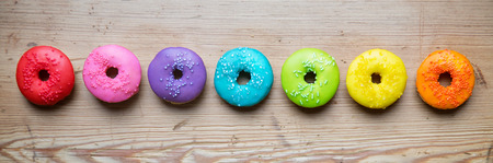 donuts: Colorful donuts in a row