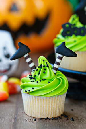 Cupcake with witch legs Stock Photo