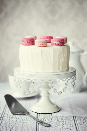 afternoon tea: Layer cake decorated with macarons