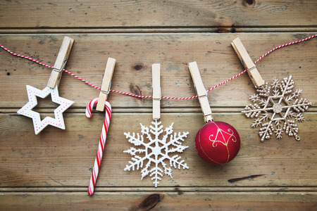 clothes line: Christmas ornaments on a wooden background Stock Photo