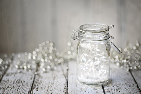 lights on: Fairy lights in a jar Stock Photo