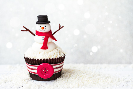 Snowman cupcake with copyspace to side photo
