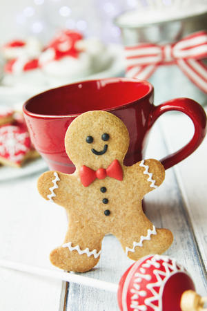 Gingerbread man and red mug photo