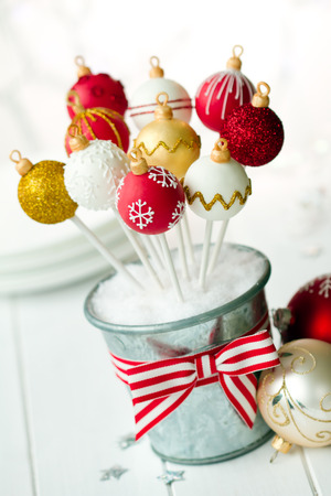 cake balls: Red, white and gold Christmas bauble cake pops Stock Photo